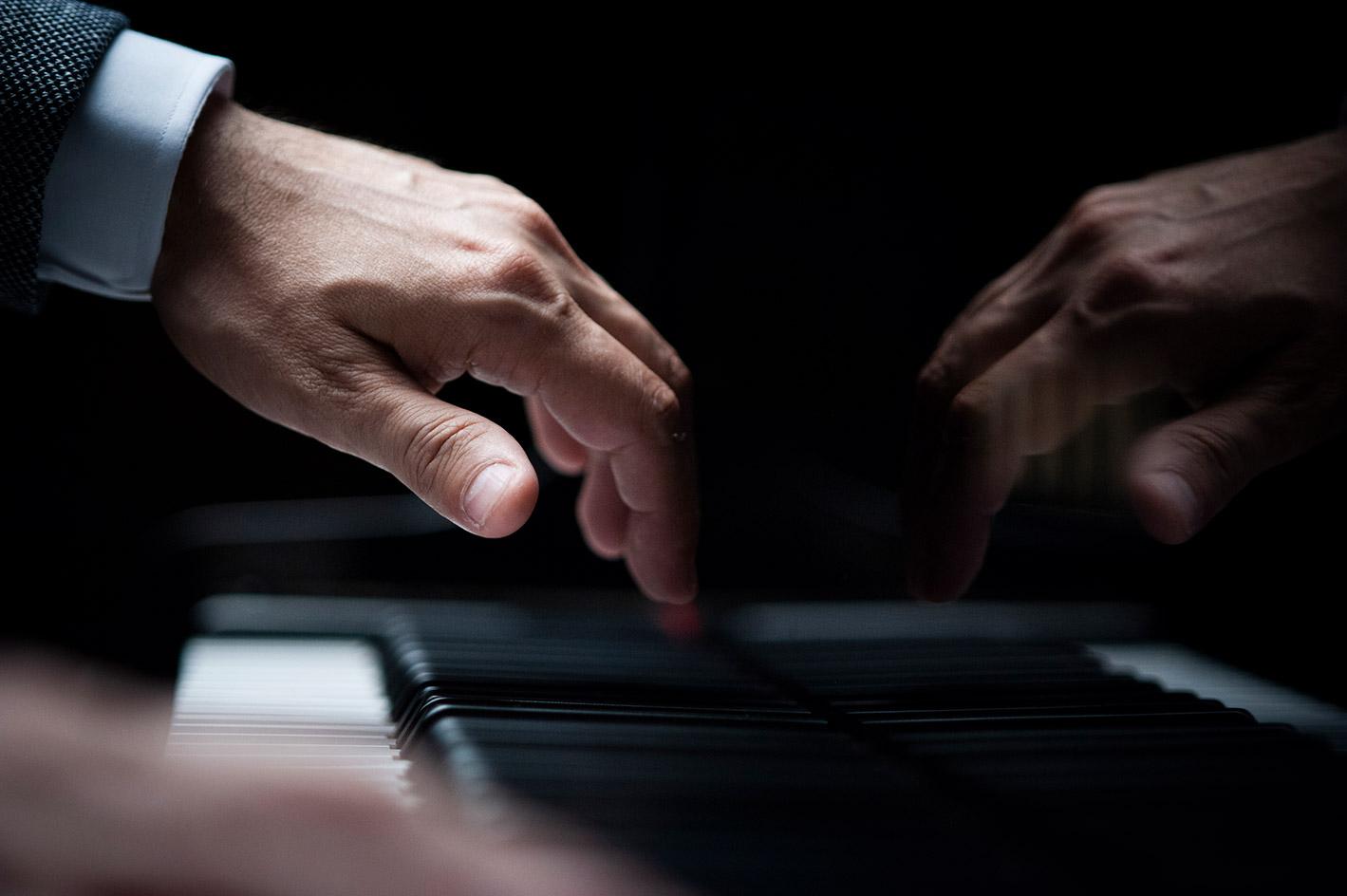 Fabio di Biase hands playing piano